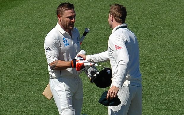 Brendon McCullum is welcomed to the crease by Australian captain Steve Smith.