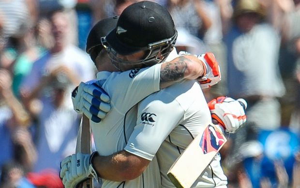 Corey Anderson embraces Brendon McCullum after the latter scored the world's fastest test century.