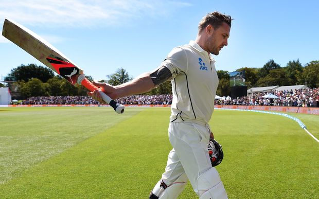 Brendon McCullum acknowledges the crowd after hitting a world record test century.