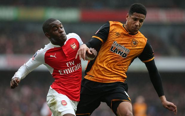 Joel Campbell of Arsenal and Curtis Davies of Hull City clash in the FA Cup - Photo: Charlotte Wilson / Offside