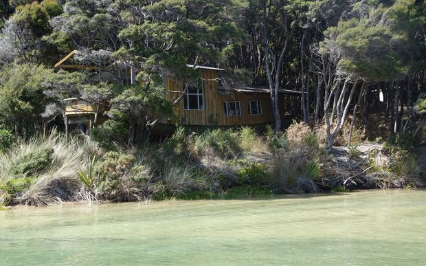 "The ""boat bach"" is one of three dwellings on the Awaroa property that now belongs to New Zealand."