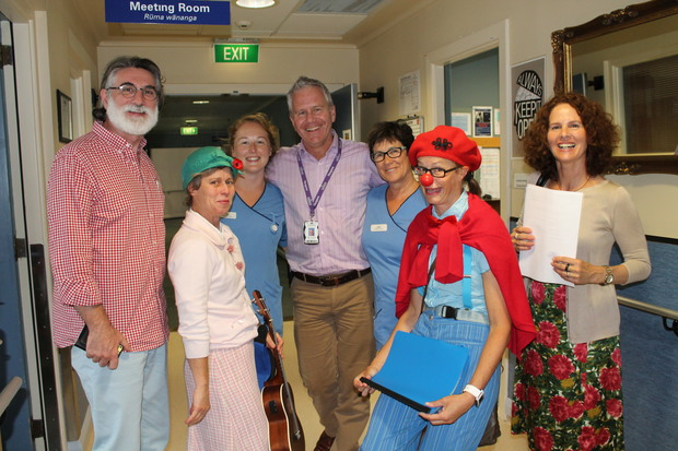 A photo of the clown doctors team with Princess Margaret Hospital staff. From left; Thomas Petschner, Dr Poppy, Pip Hyde, Andrew Henderson, Lois Robertson, Dr Betty, Rita Noetzel
