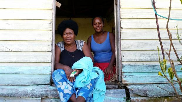 Two residents of Nadalei Village, in the remote interior of Fiji's Viti Levu Island. The village was hard hit by Cyclone Winston.