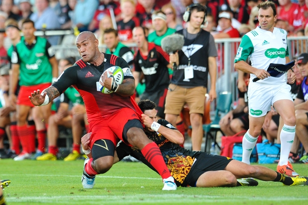 Nemani Nadolo of the Crusaders is tackled by Shaun Stevenson of the Chiefs during the Super Rugby Match, Crusaders V Chiefs in Christchurch.