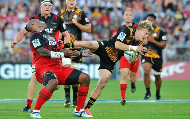 Crusaders wing Nemani Nadolo cops a face full of Chiefs fullback Damian McKenzie's boot.
