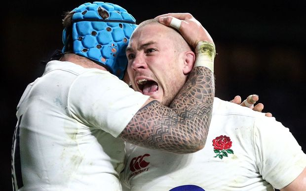 Mike Brown of England celebrates scoring a try.