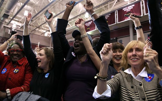 Supporters of Democratic presidential candidate Hillary Clinton celebrate her win in the South Carolina Primary over Democratic rival Bernie Sanders.