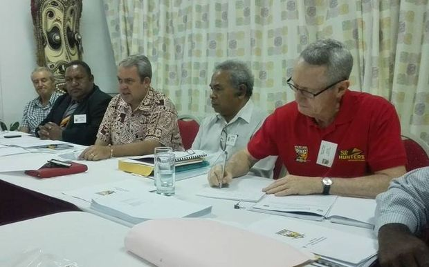 The 2016 PNGRFL AGM in Port Moresby. Among those present are Chair Sandis Tsaka, second left, Sports Minister Justin Tkatchenko, centre, and CEO Bob Cutmore, right.