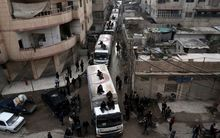 A Red Crescent aid convoy arrives in Kafr Batna on the outskirts of the capital Damascus on February 23, in cooperation with the UN to deliver aid to thousands of besieged Syrians during a partial ceasefire.