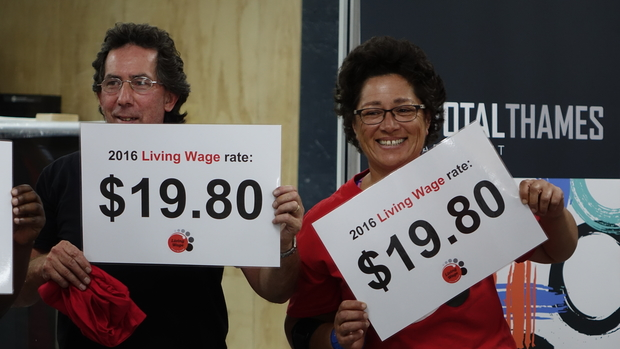 Members of Living Wage group with signs showing the 2016 living wage rate.
