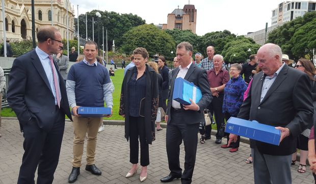 Tauranga-based patient with advanced melanoma, Leisa Renwick, outside Parliament today to present a petition to Health Minister Jonathan Coleman.
