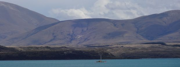 The barge at anchor at the first drill site in Lake Ohau.