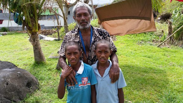 Iosefo and his twin sons in Fiji's Lavena village