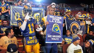 Los Angeles Rams fans cheer for the NFL football team at a news conference