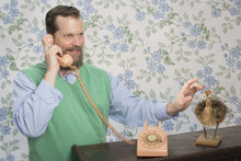 John Grant with phone and ostrich