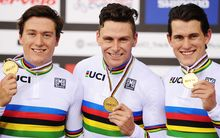 The New Zealand track cycling world sprint champions Ethan Mitchell, Eddie Dawkins and Sam Webster with their gold medals and world champion rainbow jerseys.