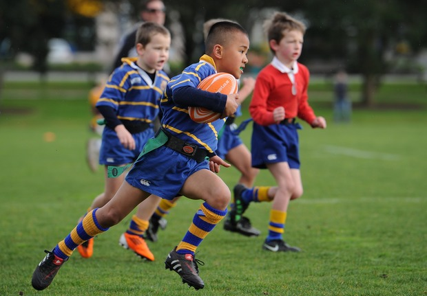 Children play a school rugby game near the Takapuna Rugby Football Club on 3 September 2011, ahead of the 2011 Rugby World Cup.