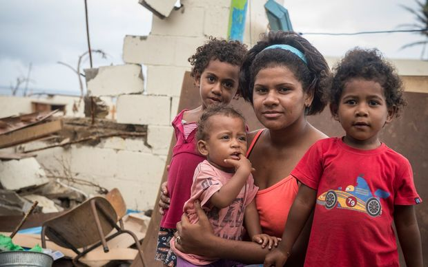 23 year-old housewife Eseta Kaitani, with her daughters Faith, 4, Ulamila, 3, and Sova, 1, at the Tuatua Nasau Primary School in Koro.