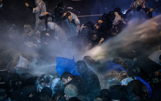 Turkish riot police use water cannons and tear gas to disperse supporters at Zaman daily newspaper headquarters in Istanbul on 5 March 5, 2016.
