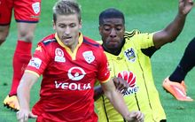 Phoenix' Roly Bonevacia battles for possession wih Adelaide United's Stefan Mauk.