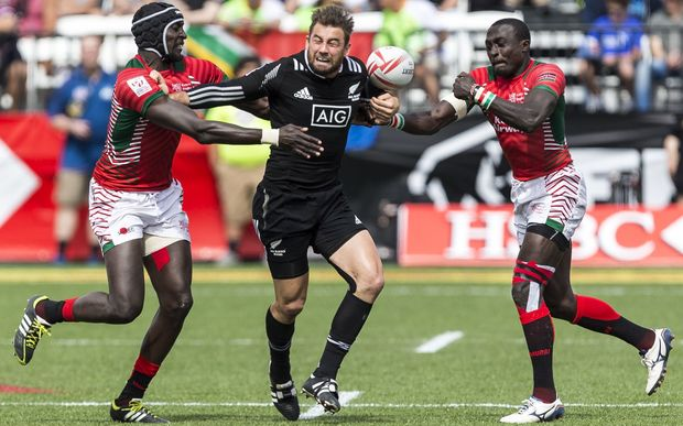 Kurt Baker is double teamed by Collins Injera and Andrew Amonde of Kenya.