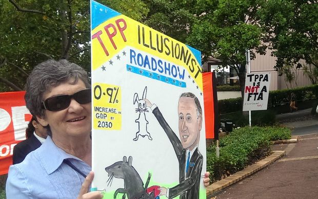 A protestor outside a seminar being held as part of the government's TPP roadshow.