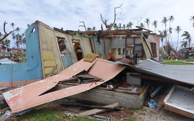 A house cut apart by a flying roof during Cyclone Winston, Fiji