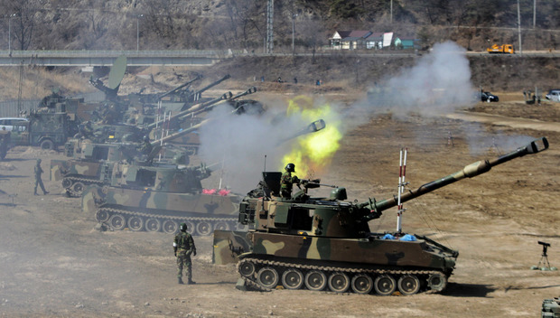 South Korean army K-55 self-propelled howitzers participate in a live fire drill during the annual South Korea-Us joint maneuvers, known as Foal Eagle, near Rodriguez Range in Pocheon, south of the demilitarized zone that divides the two Koreas, on March 15, 2012.