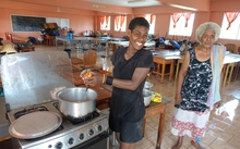 It's all smiles at the evacuation centre in Rakiraki, Fiji, preparing corned beef and noodles
