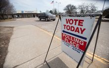 A truck leaves a polling place in Warren, Michigan, today as Michigan residents vote in their presidential primary.
