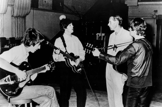 The Beatles George Harrison, Paul McCartney, producer George Martin and John Lennon