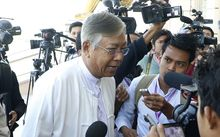 U Htin Kyaw talks with media in February at Myanmar's Lower house Parliament in the capital city of Naypyidaw.