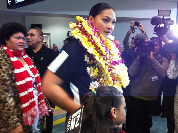 Valerie Adams was greeted by family and media at the airport.