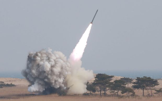 This undated picture released from North Korea's official Korean Central News Agency (KCNA) on 4 March, shows a test-fire of the new large-caliber rocket at an undisclosed location.