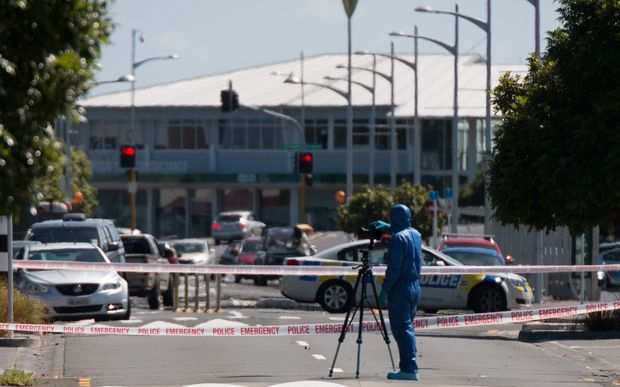 Police gather evidence on Railway Street West after a shooting in Papakura early Saturday morning left one man dead and another seriously injured.