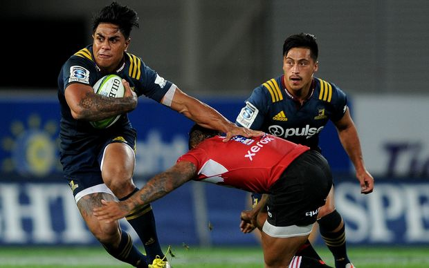 Malakai Fekitoa of the Highlanders looks to break the Lions' defence.