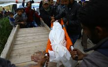 Mourners bury the body of 6 -year-old Palestinian Girl Esra Abu Khoussa.