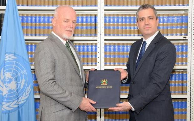 Fiji's Permanent Representative to the United Nations, Peter Thomson, receives the instruments of ratification for the UN Convention Against Torture at the UN