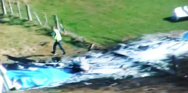This television frame grab taken from TVNZ television on September 4, 2010 shows the wreckage of a Fletcher FU24 turbine powered skydiving aircraft in a field near Fox Glacier.