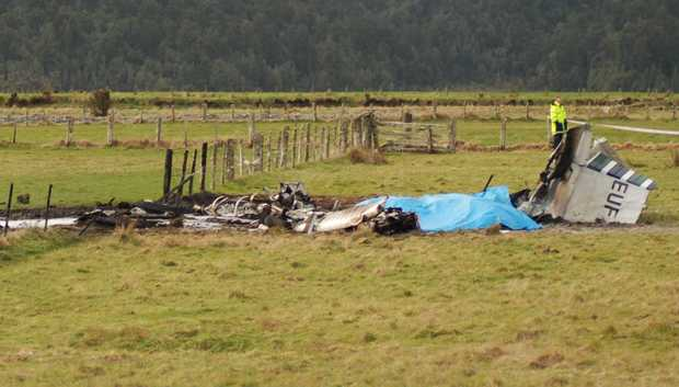 The wreckage of the crashed skydiving plane is seen at the end of the runway at Fox Glacier Airport on 4 September, 2010.