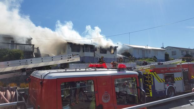 Smoke pours from a house on Te Pene Avenue, Titahi Bay.