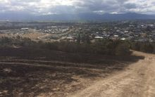 The damage from the recent blazes can be seen clearly on the hills above Blenheim.