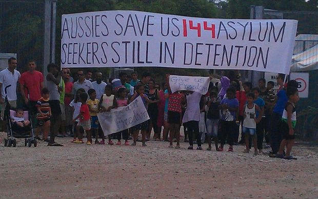Protesters gather outside the family compound of the asylum seeker detention centre on Nauru.