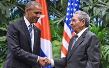 US President Barack Obama, left, and Cuban President Raul Castro shake hands during a meeting at the Revolution Palace in Havana on 21 March 21, 2016.