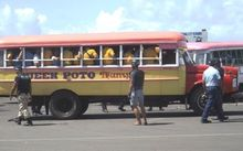 Samoa police surround bus at bus terminal in Apia for searches after student brawls in March 2016