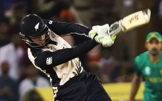 The Black Caps opener Martin Guptill hits a boundary against Pakistan.