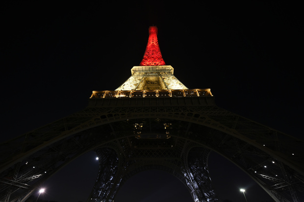 The Eiffel tower in Paris lights up in the Brussels national colours of black, yellow and red.