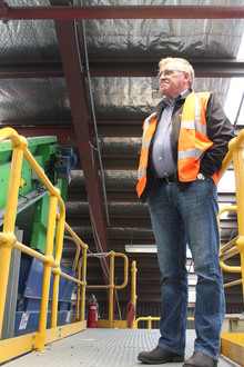 A photo of SDE General Manager, Ian Beker surveying the recycling operation