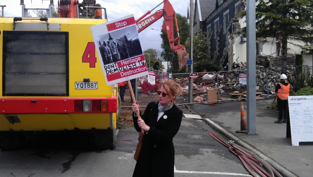 A protester at the Cranmer Courts site. Work began to demolish the heritage building on Thursday.