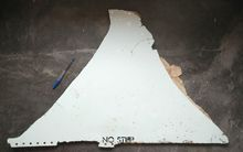 One of the pieces of debris found in Mozambique thought to be from MH370. It reads 'no step'.